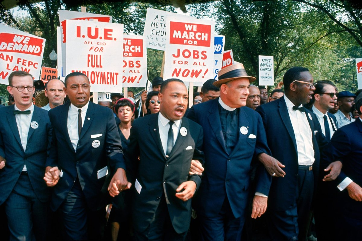 Leaders of March on Washington for Jobs & Freedom marching w. signs (R-L): Matthew Ahmann, Floyd McKissick, Martin Luther King Jr., Rev. Eugene Carson Blake and unident.